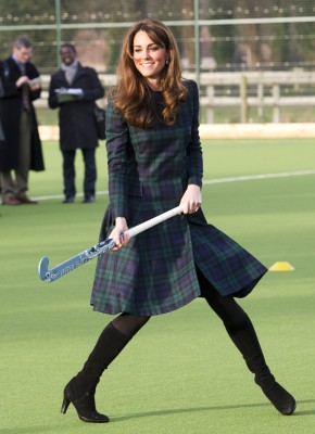 Britain's Catherine, Duchess of Cambridge, plays hockey with students during her visit to St Andrew's School, where she attended school between 1986 a...