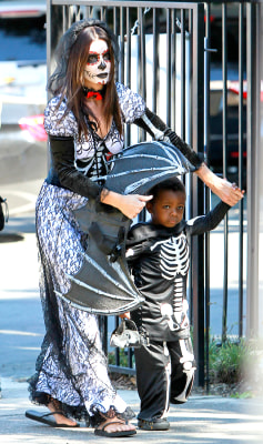 Sandra Bullock takes son Louis to a Halloween party at his school in Los Angeles.