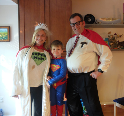 4-year-old Tucker Campbell is Superman, flanked by Supermom Kristi and Superdad Robert