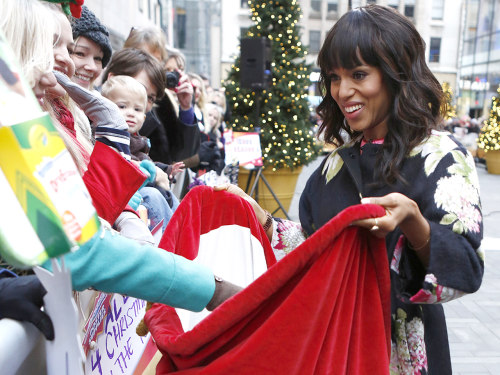 Kerry Washington collects toys on the plaza for the annual Toy Drive.