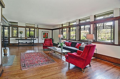 Wright emphasized the home's open floor plan by building a narrow entry way, maximizing the effect of walking into the living room.