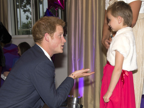 Britain's Prince Harry (L) talks with Maidison Kirk (R), 6, as he attends the annual WellChild awards in central London on September 11, 2013. Prince ...