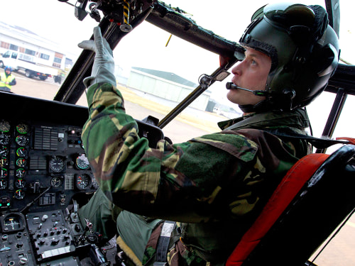 A handout file photograph shows Britain's Prince William inside his helicopter in Anglesey, Wales January 22, 2011. William officially ended his servi...