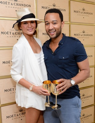 NEW YORK, NY - SEPTEMBER 02:  Model Chrissy Teigen and singer John Legend visit the Moet & Chandon Suite at the 2012 US Open at the USTA Billie Jean K...