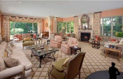 """Measuring 9,000 square feet, the estate has 7 bedrooms, 9 bathrooms and a mix of formal and casual living spaces, all with large windows opening out to the landscaped, """"park-like"""" grounds and pool."""