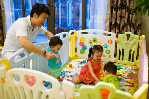 Tony Jiang poses with his three children at his house in Shanghai September 16, 2013. In December 2010, Jiang, a Shanghai businessman and his wife wel...