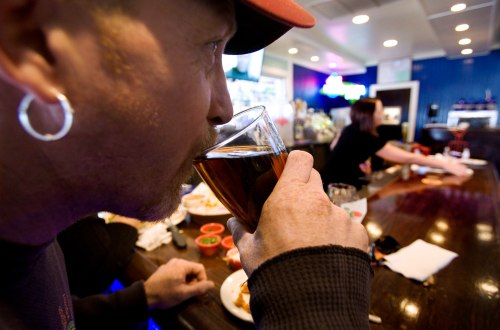 R. Woodland, of Murray, Utah, sips on his beer at a Chili's restaurant Sunday, Feb. 15, 2009, in Midvale, Utah. Last month, Utah Senate President Mich...