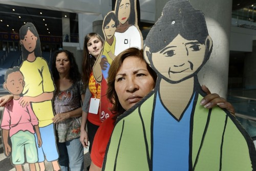 Guillermima Castellamos, a former domestic worker now an organizer for National Domestic Workers Alliance, holds on to a cardboard cutout of a domesti...
