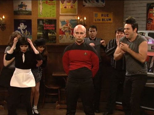 "Image: the cast of ""Saturday Night Live,"" along with host Anna Kendrick, welcome Capt. Jean-Luc Picard."