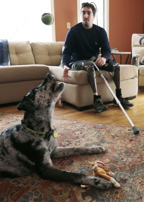 ADVANCE FOR WEEKEND USE APRIL 4-5 -- In this March 14, 2014 photo, Jeff Bauman, plays catch with his dog Bandit, at his Carlisle, Mass., home. Bauman,...
