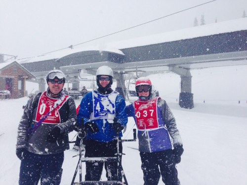 Patrick Zeigler, center, with the trainers -- from the National Disabled Veterans Winter Weather Sports Clinic in Snowmass, Colo. -- who helped him learn to ski.