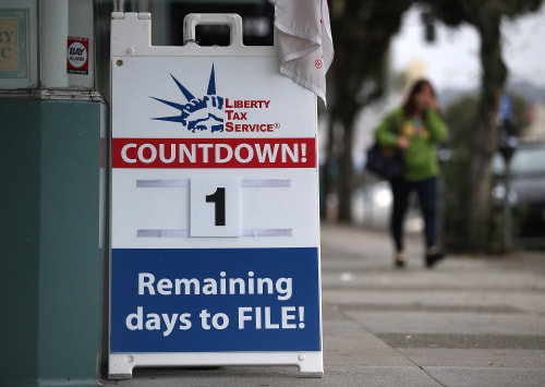 SAN FRANCISCO, CA - APRIL 14:  A sign advertising one day remaining before the tax filing deadline is posted in front of  Liberty Tax Service on April...