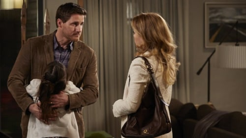 "Joel (Sam Jaeger) and Julia (Erika Christensen) with their daughter Sydney (Savannah Paige Ray) in a scene from the fifth season finale of ""Parenthood..."