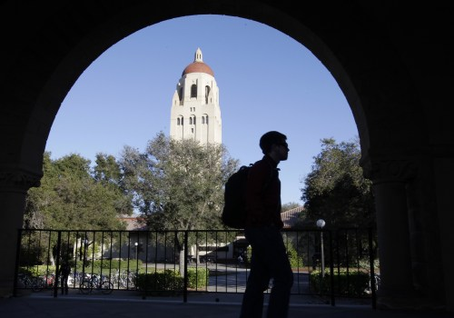 FILE - In this Feb. 15, 2012 file photo, a Stanford University student walks in front of Hoover Tower on the Stanford University campus in Palo Alto, ...