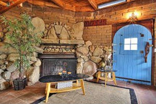 The fireplace provides a cozy spot in this handmade cottage.