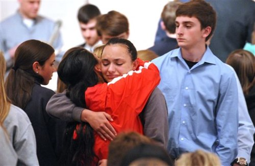 Friends and family including many students from Jonathan Law High School attend a memorial service at the First United Church of Christ in Milford Con...