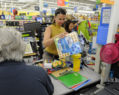 Heather Savage, with her daughter, Mallory, makes sales tax holiday purchases during the three-day tax holiday event at the Wal-Mart on Friday, Aug. 1...