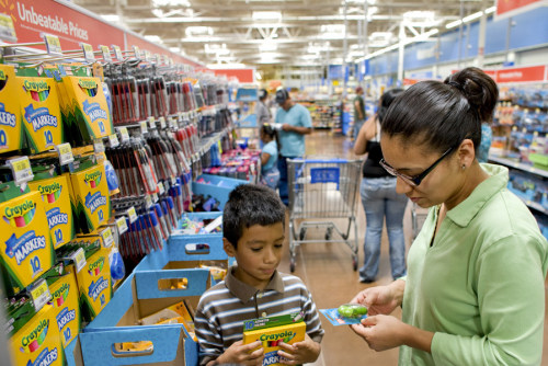 Guadalupe Orosco and her children Luis, 9, starting fourth grade, and David, 7, starting third grade, shop in the school supply aisles as part of back-to-school shopping at a Wal-Mart store in Thornton, Colo.