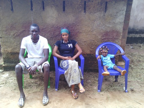 Sara Laskowski had to tell her host family in Guinea (L to R: Ibro, Djenab, Bountourabi) that she would leave while they must stay.