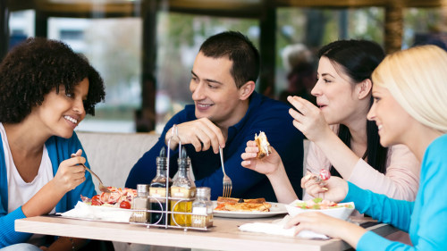 Four cheerful friends chatting while lunch in restaurant; Shutterstock ID 125612351; PO: TODAY.com