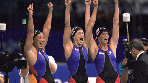 16 Sep 2000:  Amy Van Dyken, Dara Torres and Courtney Shealy of the United States exhalt after the Women's 4x100 Meter Relay final at the Sydney Inter...