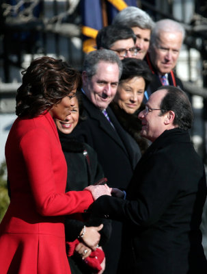 The French president greets Michelle Obama during a welcoming ceremony at the White House on Tuesday morning.
