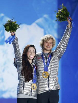 Gold medallists Meryl Davis and Charlie White of the U.S. celebrate during the medal ceremony for the figure skating ice dance free dance program at t...