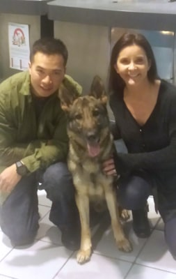 Sgt. Calvin Aguilar, Kristen Maurer and Nico the dog