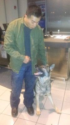 Sgt. Calvin Aguilar reunites Nico the dog.