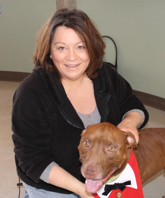 Soldier, a pit bull who was found with a mystery photo tucked inside his collar, is pictured with Julie Hensley, his new owner.