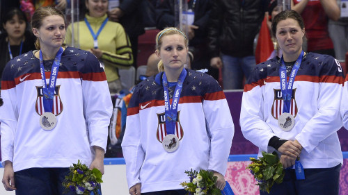 US players cry during the Women's Ice Hockey Medal Ceremony at the Bolshoy Ice Dome plaza during the Sochi Winter Olympics on February 20, 2014.    AF...