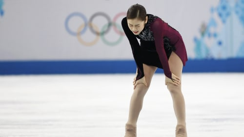 Korea's Yuna Kim reacts at the end of her program during the Figure Skating Women's free skating Program at the Sochi 2014 Winter Olympics, February 2...