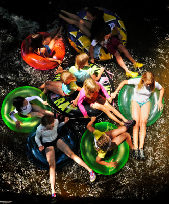 Summer might seem far off, but now's the time that parents start signing up their kids for camp. Girls from Nancy's Summer Camp in Boulder, Colo., hold onto each other as they float down Boulder Creek.