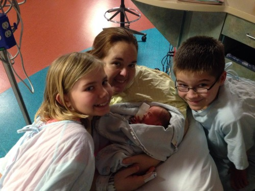 One big(ger) happy family: Caleb, 12, and Kaitlyn, 9, bond with their stepmom Amanda and one of their three new baby sisters.