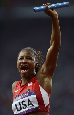 Lauryn Williams of the U.S. celebrates after her team won their women's 4x100m relay heat during the London 2012 Olympic Games at the Olympic Stadium ...