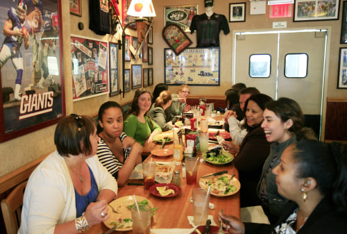 In this June 3, 2009 photo, customers enjoy lunch at an Applebee's Neighborhood Grill & Bar, in New York. (AP Photo/Mark Lennihan)