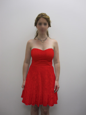 This is the picture used for the color manipulation in Experiments 1 and 2 (the face of the female target was intact in the experiment but is blurred here to protect privacy). The dress color was red or white.