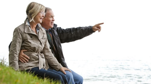 older casual couple sitting in the grass outdoors; Shutterstock ID 114427078; PO: today.com