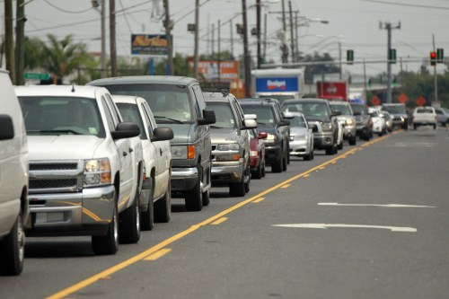 A line of traffic extends down Airline Highway as residents leave the New Orleans area in anticipation of Tropical Storm Isaac, in Kenner, La., Monday...