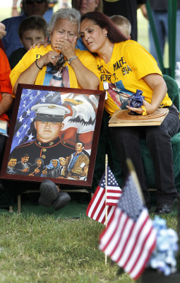 Hope Dorris, left, is comforted by her daughter, Patsy Maciel, the mother of Lance Cpl. Fred Maciel, who died in a helicopter crash in Iraq more than ...