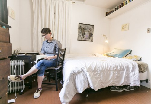 Image: Airbnb guest Megan Walsh, a Chicago writer on a summer internship, reads in her room at the Echo Park home of artist Jonathan Entler on May 19 in Los Angeles.
