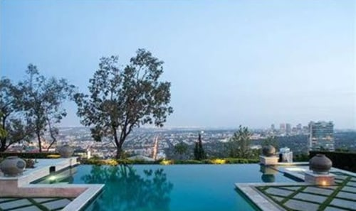 The property includes a pool and patio with L.A. views.