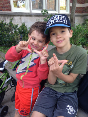 "Erica's sons Weston (7) and Sawyer (4) flashing ""L""s on the morning they walked / biked to school with their mother, for a total of 3 OutRUN miles (one from each of them)."