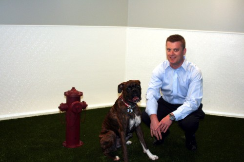 "A new ""dog lounge"" lets Spencer Norris bring his boxer, Benny, to his downtown Seattle office."