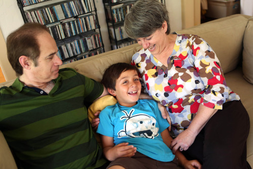 Kerry and Jed Silverstrom with their eight-year old adopted son Gus, in their home in Los Angeles, June 22, 2014.