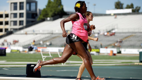 A pregnant Alysia Montano runs in the opening round of the women's 800 meter run at the USATF Outdoor Championships in Sacramento, California.