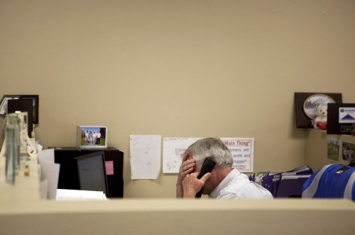 In this Feb. 15, 2012 photo, Steve Wyard, 61, a regional sales director of All Valley Washer Service, talks on the phone in his office in the Van Nuys...