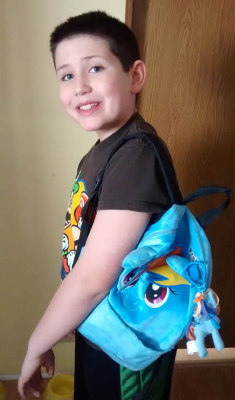 Image: Grayson Bruce, 9, with his My Little Pony backpack.