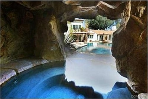 The Spanish-style home that rocker Pink is selling in Sherman Oaks has a pool with an in-ground cave-like spa tucked behind a waterfall.