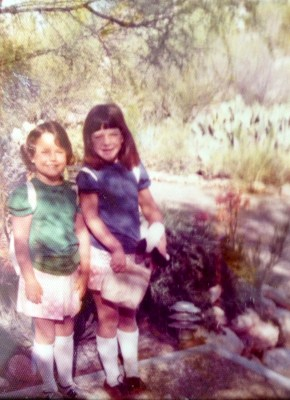 Savannah and her sister on the first day of school in coordinating outfits.
